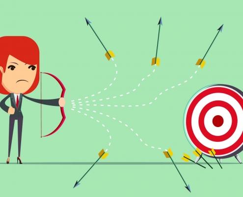 Woman shooting arrow at target
